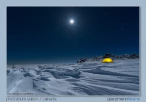 Igloo Pictures Arctic Landscape Photography. Tent shot at night long time exposure with snow drifts in moon shine. Extrem Winter Night Photography Tours.