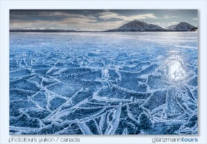 Kathleen Lake Landscape Photo Workshops Kluane National Park. Frozen lake surface with cristals, sun light reflection on ice, beatiful photograph.