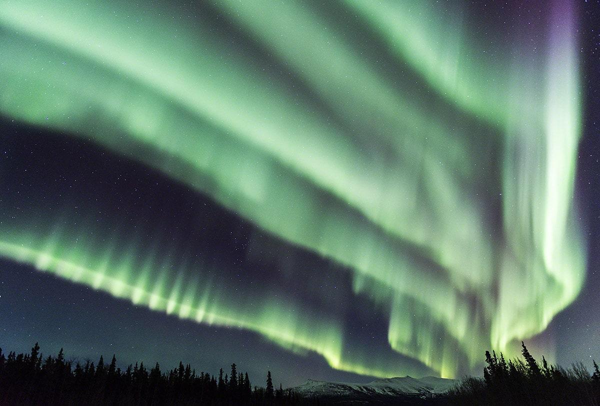 Heftiger Nordlichtersturm während eines Fotoworkshops im Yukon. Reisen und fotografieren im hohen Norden mit Profifotograf